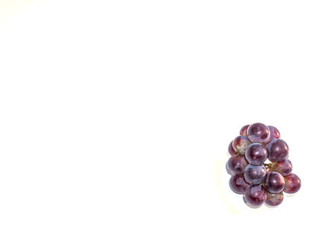 Harvest grapes berries on a white background. Grape juice. Winemaking. Wine production. Fruit shop showcase. Grape gardening. Agriculture. Place for text. Dried fruits. Garden fruits. Stock fotó