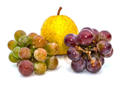 Harvest grapes berries on pears fruits white background. Grape juice. Pear juice. Winemaking. Take a pear. Fruit shop showcase. Grape gardening. Agriculture. Place for text. Dried fruits. Stock fotó