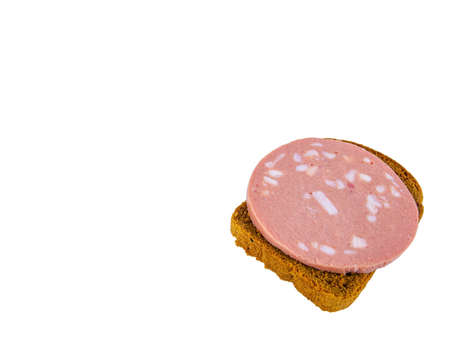 Black bread sandwich with pork sausage and lard on a white plate. Black bread. Meat sausage. Pig fat. Pork product. Fatty food. Non vegetarian food. Meat dish. Home kitchen. White background.