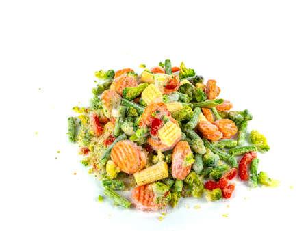 Fresh frozen vegetables on a white plate. Freezing vegetables and fruits. Freshly frozen foods. Vegetable in the freezer. Storing a vegetable in the refrigerator. Freezing vitamin. Vegetarianism. Stock fotó