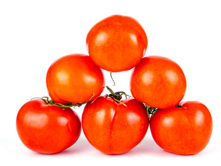 Red tomatoes vegetables on a white background. Stock fotó