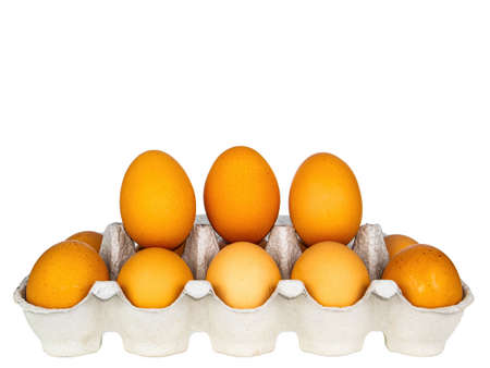 Chicken eggs in cardboard packaging on a white background.