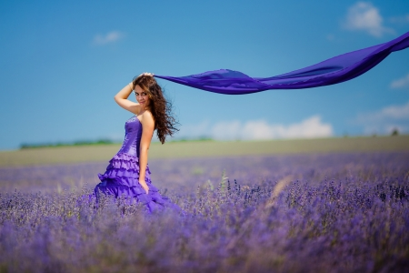 Portrait of beautiful romantic woman in fairy field of lavender with a colored tissue Stok Fotoğraf - 15223663