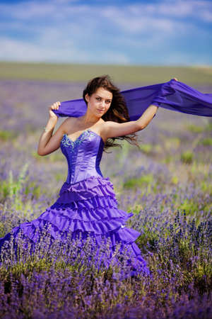 Series. Portrait of beautiful romantic woman in fairy field of lavander  photo