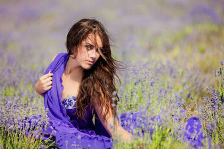 Close up portrait of a beautiful woman on a lavender field at summer  photo