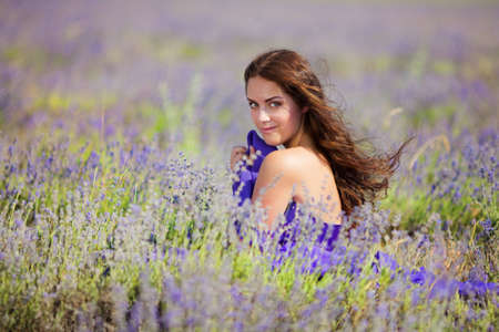 lavage: Close up portrait of a beautiful woman on a lavender field at summer