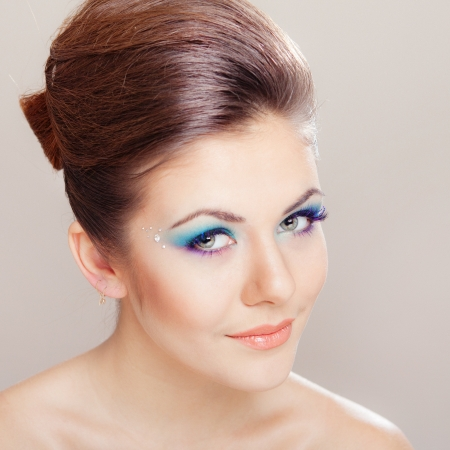 Closeup portrait of beautiful  young woman with blue glamour makeup  photo