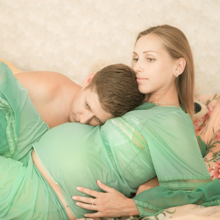 gestation: Beautiful young pregnant couple at home