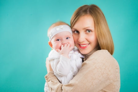 daugther: Happy young mother with her baby  Happy family with newborn  Stock Photo