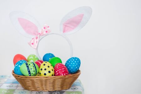 Happy Ester. View of multicolored Easter eggs with handmade ornament.