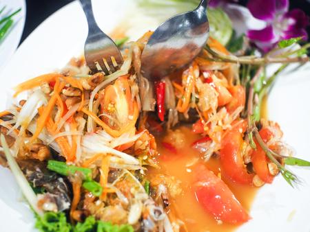 Papaya salad, spicy, bright colors