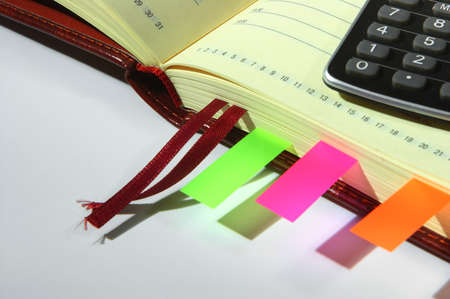 Open notebook with calculator and stickers Stock Photo - 12252808