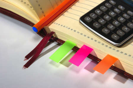 notebook with calculator, pen and stickers Stock Photo - 12252814