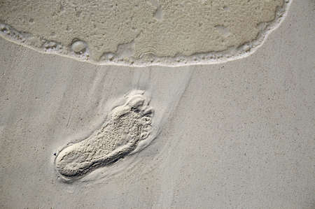 Fun footstep on a coral sandy beach photo