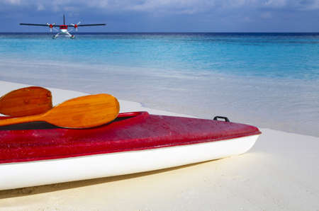 Paddle red boat is on a sandy beach photo
