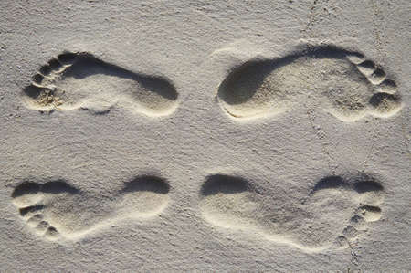 Fun four footsteps on a coral sandy beach photo