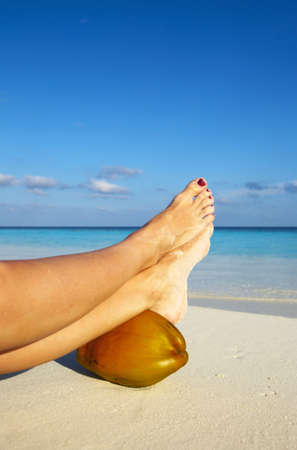 Woman is resting on a coast of ocean
