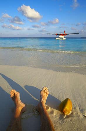 Pilot has a rest on a sandy beach, Maldives