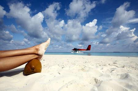 Airwoman has a rest on a sandy beach, Maldives