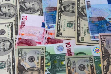 meanness: Heap of dollars of the USA and  EURO