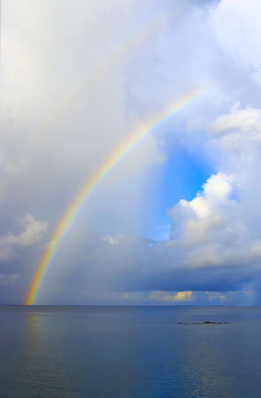 Nice seascape with rainbow in the Indian Ocean (vertical) Stock Photo