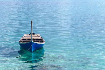nirvana: Nice boat near the coast of calm ocean