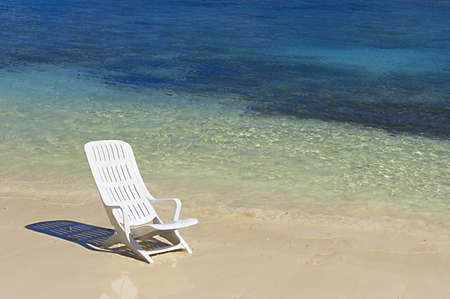 Chair are waiting  you on a white sandy beach in the turquoise waters of Indian Ocean, Maldives Stock Photo - 12627146