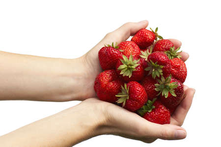 A pair of female hands hold colorful strawberries Stock Photo