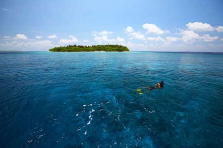 uninhabited: Snorkeling near uninhabited island island in the Indian Ocean, Maldives Stock Photo