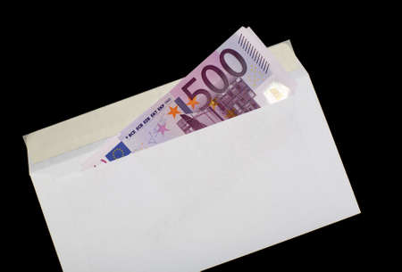 subornation: Euro in white envelope, isolated on a black background
