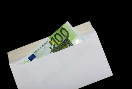 Euro in white envelope, isolated on a black background photo