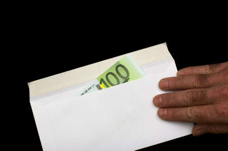 payola: Euro in white envelope, isolated on a black background