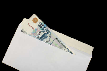 subornation: Russian roubles in white envelope, isolated on a black background
