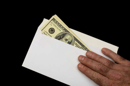 American dollars in white envelope, isolated on a black background photo