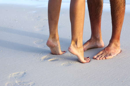hairy male: Couple is on the sandy beach Stock Photo