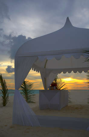 wedding tent on the sunset beach photo