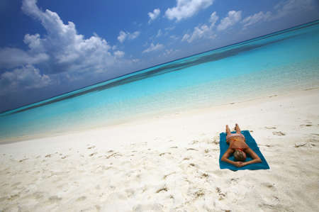 Young women is sunburning on the coast of the Indian Ocean, Maldives photo