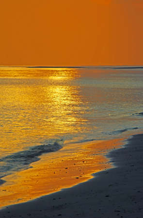 nirvana: Gentle sunset seascape in the Indian Ocean  vertbcal  Stock Photo