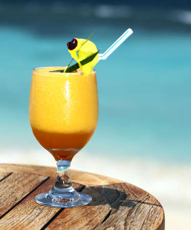 Bocal of fruity cocktail on a beach table Stock Photo - 13103342
