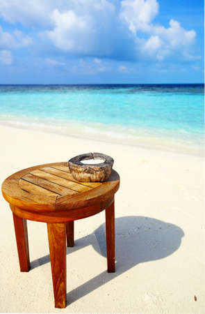 Ashtray on a beach table photo