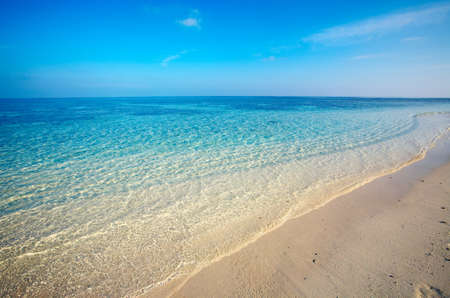 Sand tropical beach on uninhabited island, Maldives