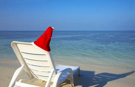 Armchair are waiting you on a white sandy beach in the Indian Ocean, Maldives photo