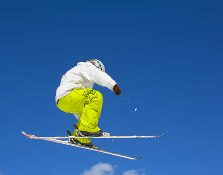 Skier and a blue sky Stock Photo - 13121505