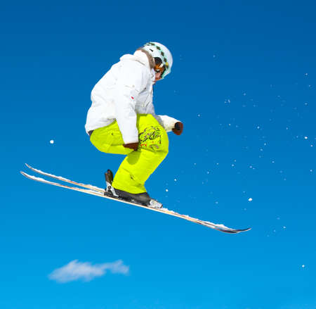Skier and a blue sky photo
