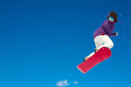 Snowboarder and a blue sky Stock Photo - 13121278