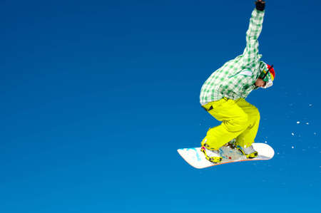 Snowboarder and a blue sky photo