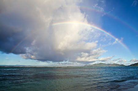 Nice seascape with double rainbow in the Indian Ocean Stock Photo