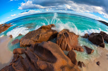 ladigue: Seascape  fisheye view  with a huge stones, Seychelles, LaDigue island, The Indian Ocean