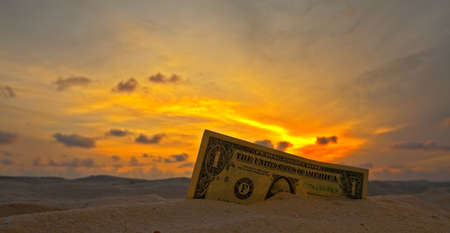 One dollar on a sunset Stock Photo