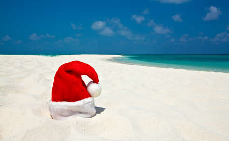 Santa hat is on infinity coral sandy beach Stock Photo